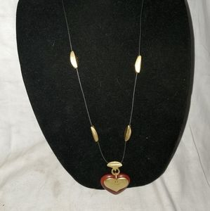 Black cord with plastic and metal heart necklace